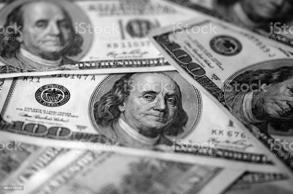Hundred dollar bills background close up, black and white stock photo
