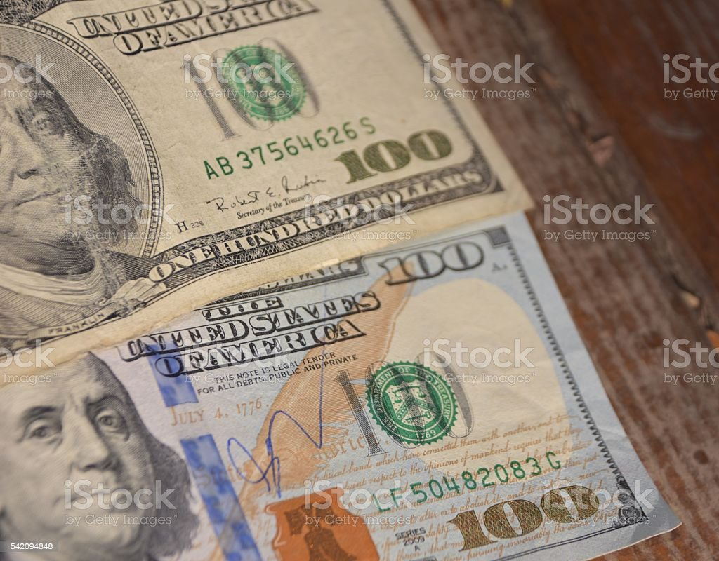 Hundred Dollar Bills for background. Old and new banknotes stock photo