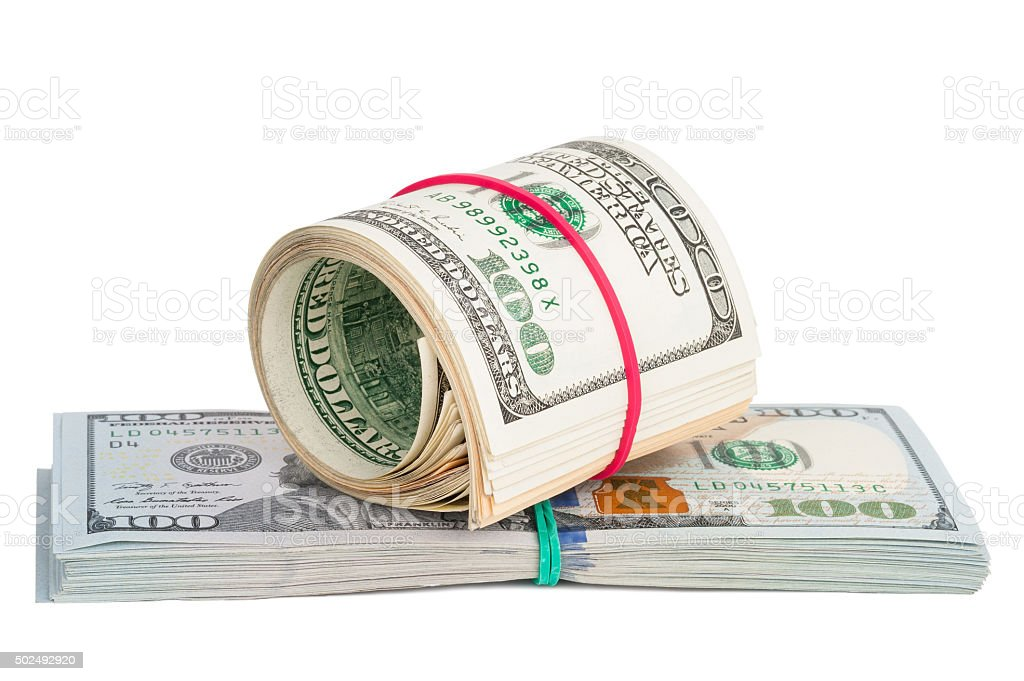 Hundred dollar bills rolled up with rubberband stock photo