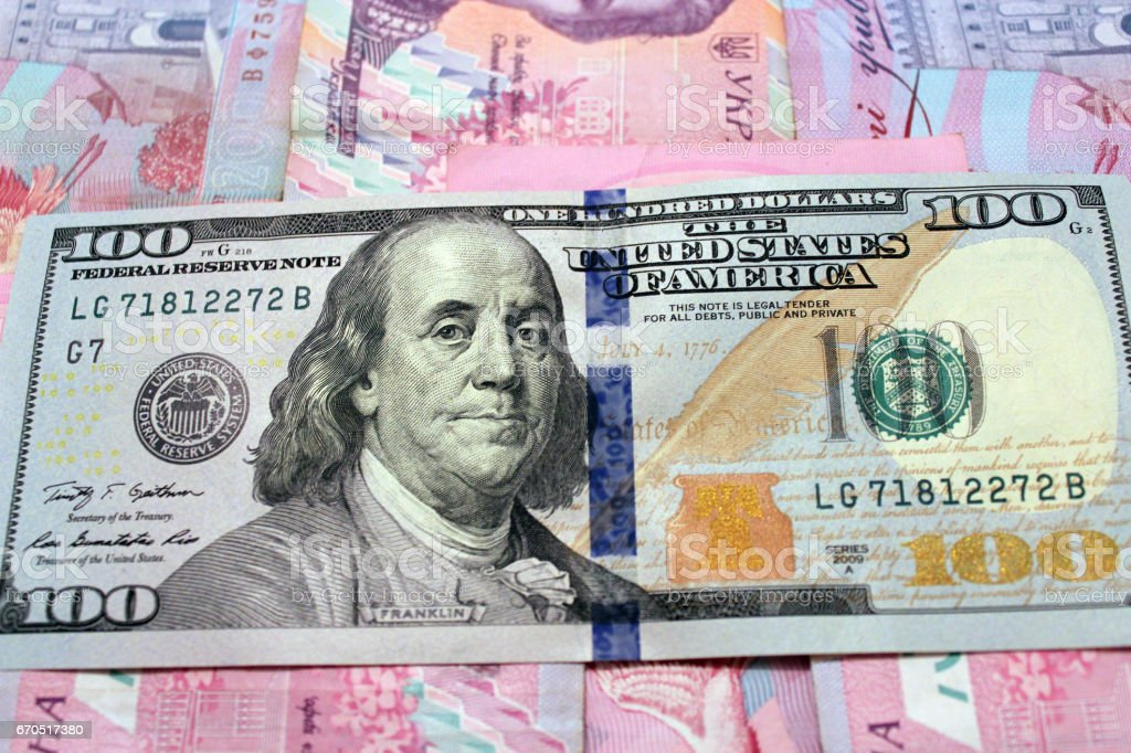 hundred dollars on the Ukrainian grivnas banknotes stock photo