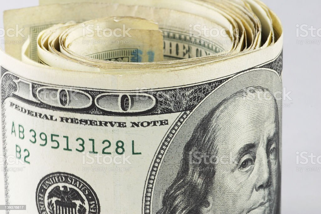 Hundred Dollars rolled royalty-free stock photo