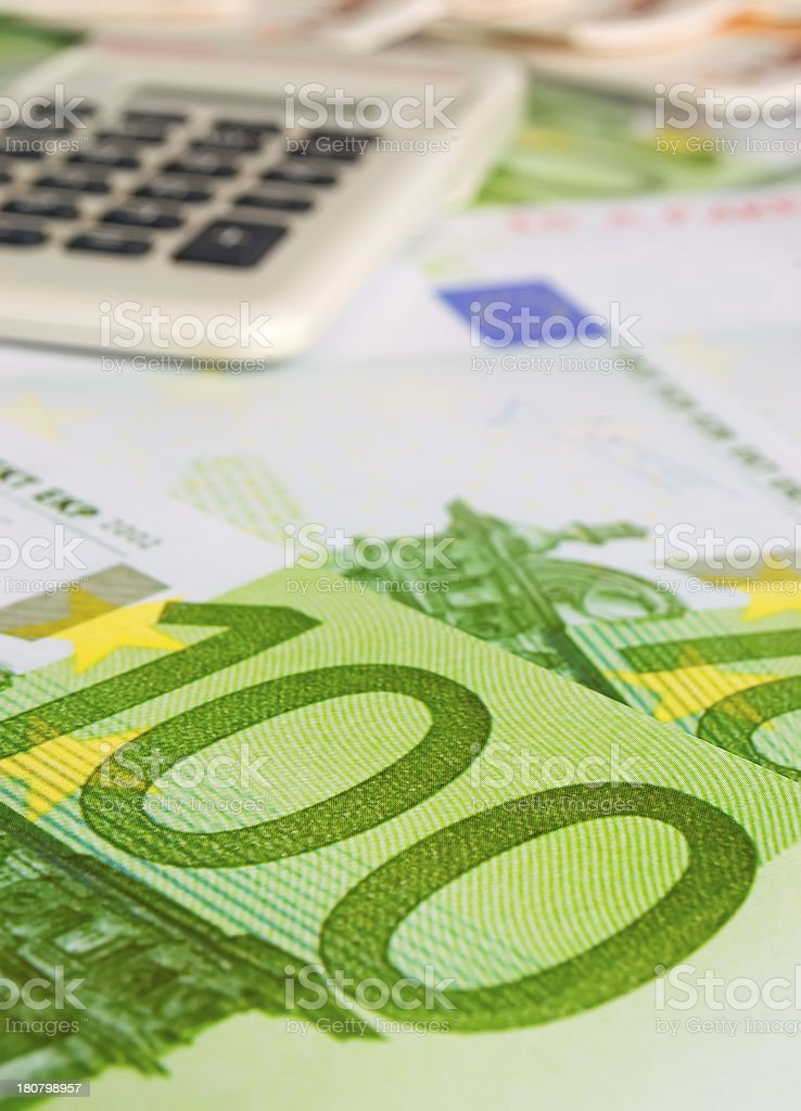 hundred euros and calculator royalty-free stock photo
