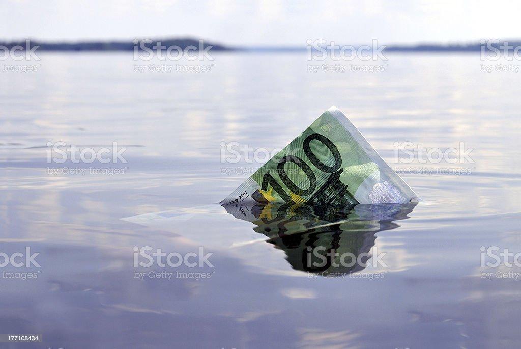 Hundred euros sinking royalty-free stock photo