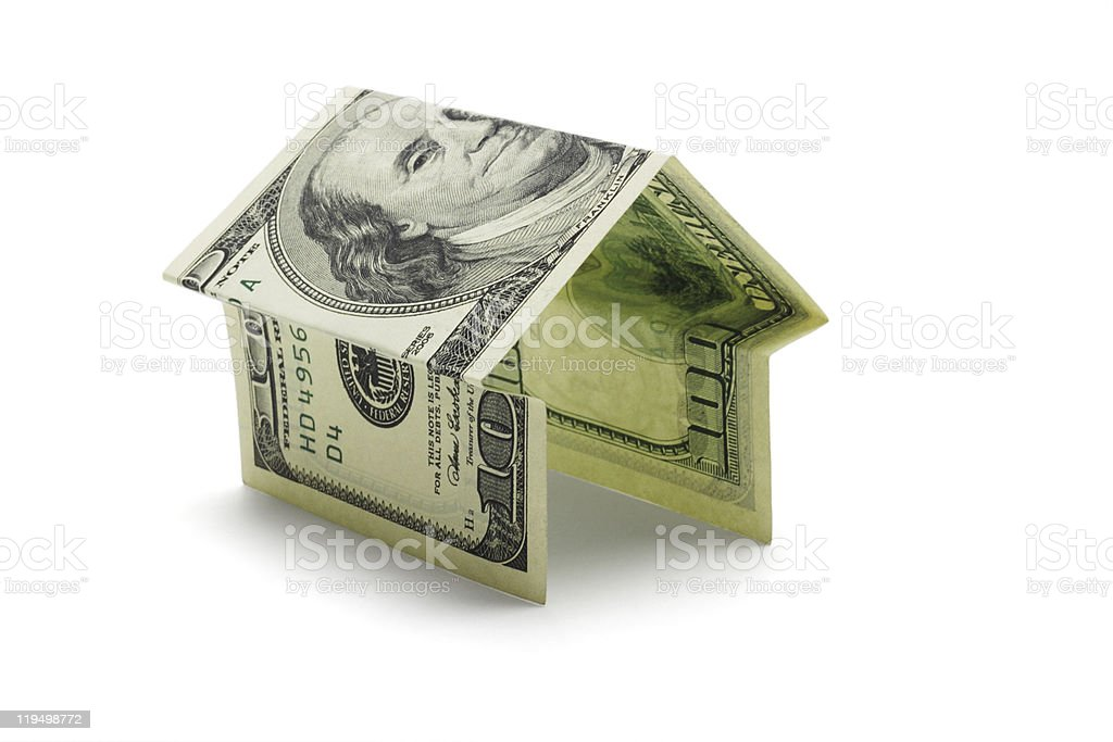 Hundred US dollar note in shape of house stock photo