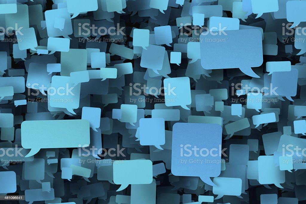 Hundreds of blank blue speech bubbles stock photo