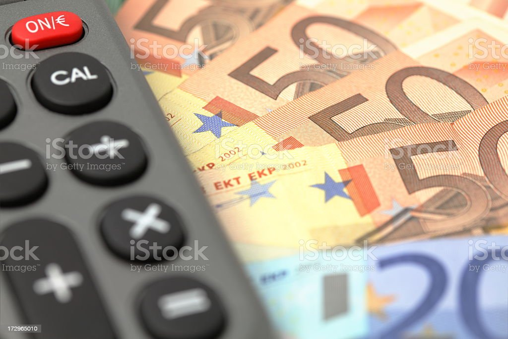 Hundreds of Euro notes with calculator royalty-free stock photo