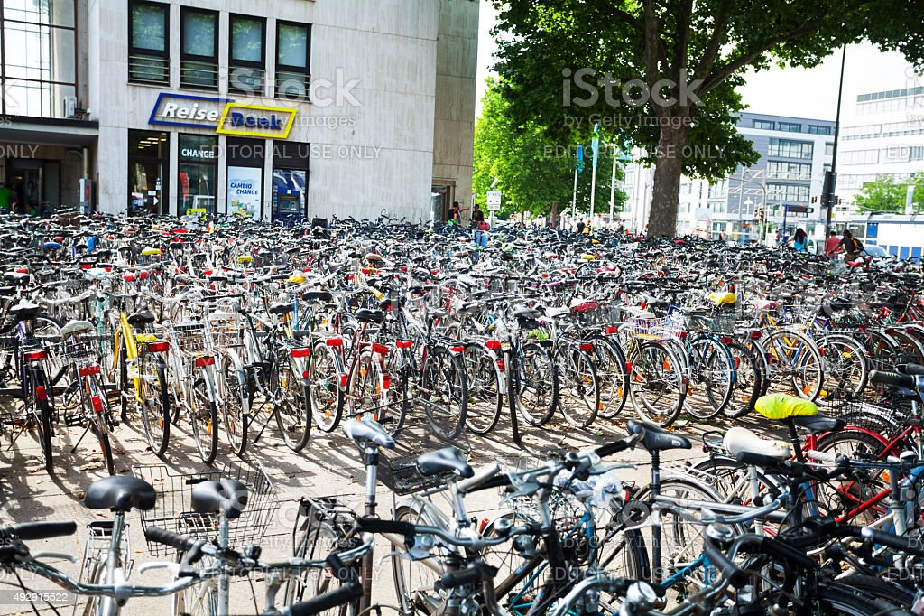 Hundreds of parked bicycles stock photo