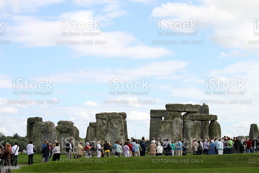 Hundreds of tourists gather at the ancient monument, Stonehenge, Wiltshire royalty-free stock photo