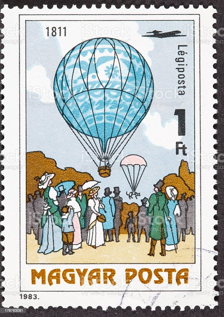 Hungarian Air Mail Postage Stamp Menner Dropping Cat With Parachute royalty-free stock photo