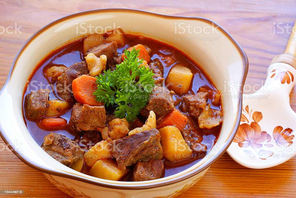 Hungarian goulash in a bowl with a spoon stock photo