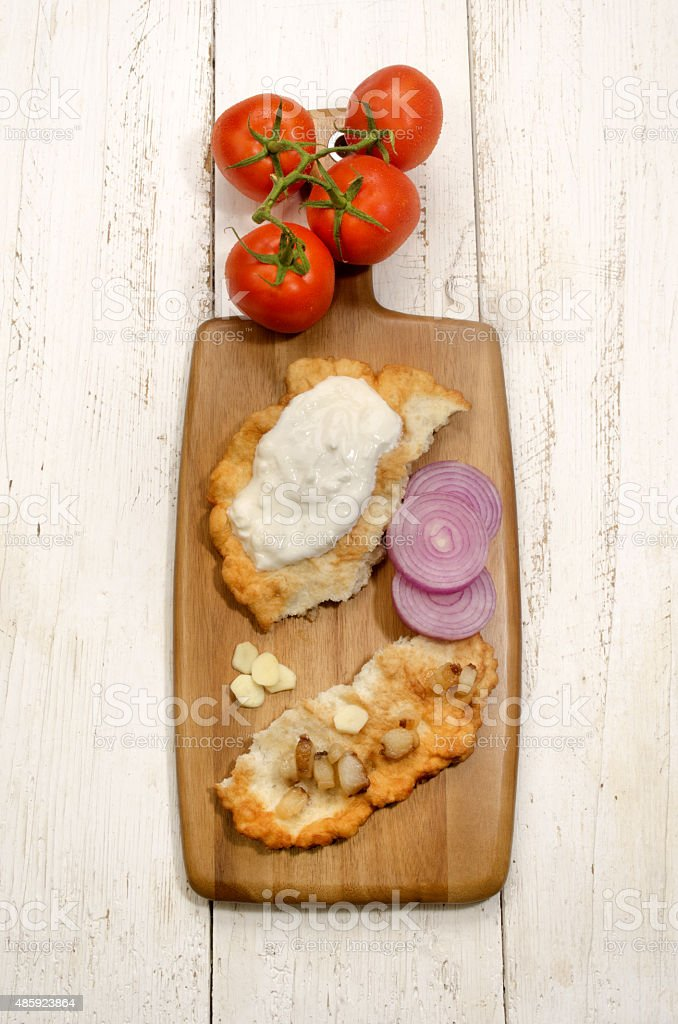 hungarian langos with onion and bacon stock photo