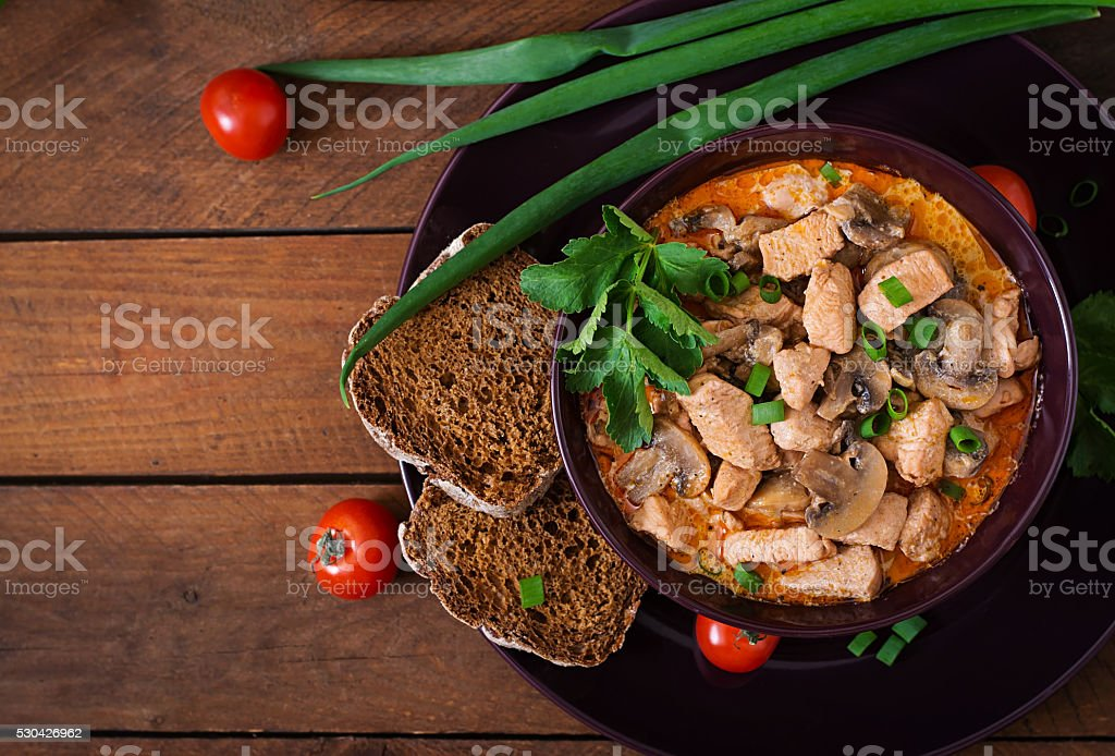 Hungarian paprikas (goulash) chicken with mushrooms stock photo