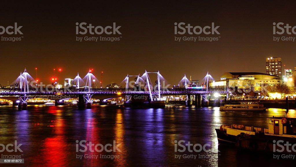 Hungerford Bridge and Golden Jubilee Bridges at Night stock photo