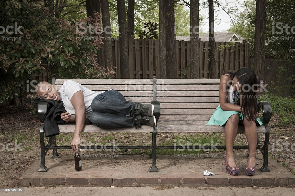 Hungover Couple on Park Bench stock photo