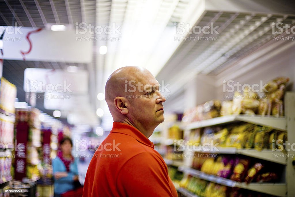 Hungry Bald Man in a food store royalty-free stock photo