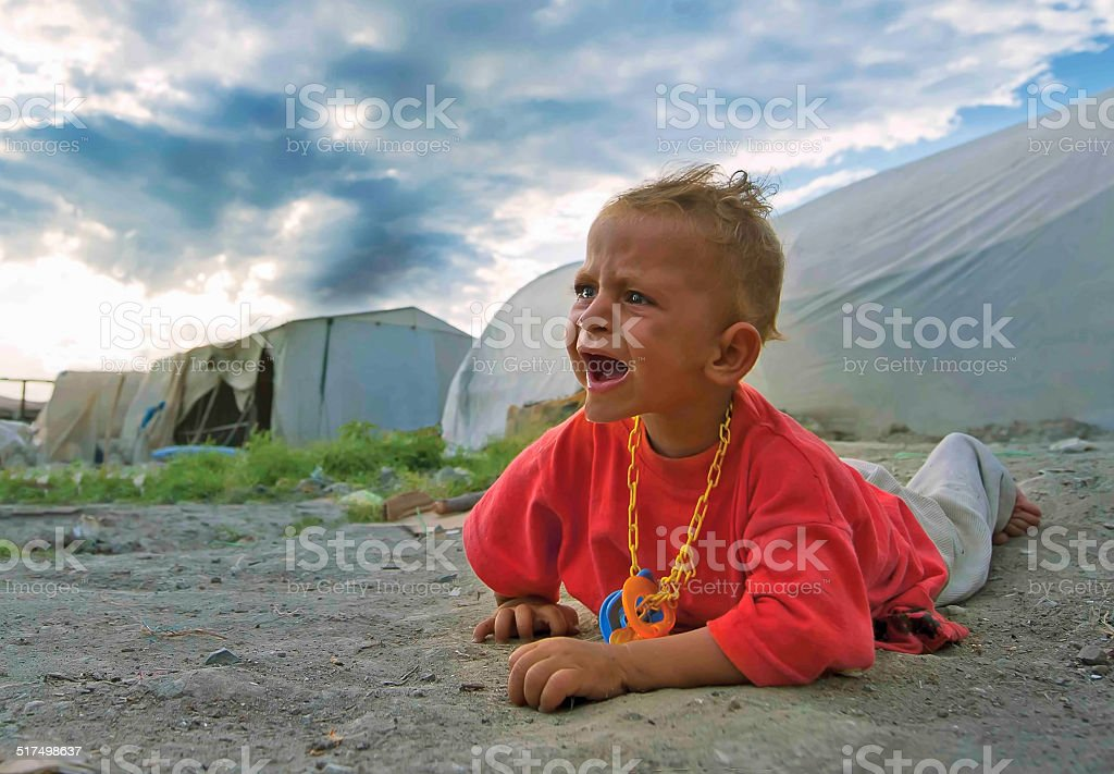 Hungry children in refugee camp stock photo