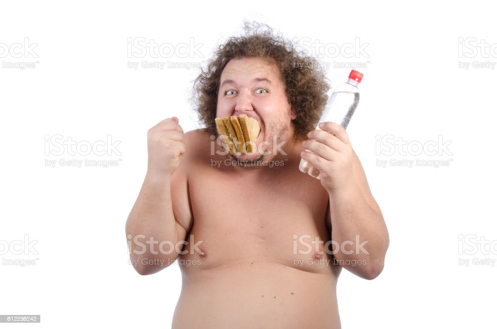Hungry fat guy with a sandwich. stock photo