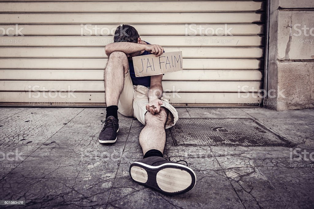 Hungry, homeless man begging on street of French city stock photo