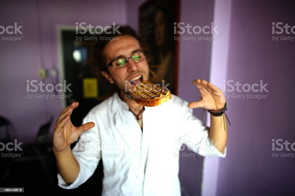 Hungry man eating biting floating sandwich stock photo