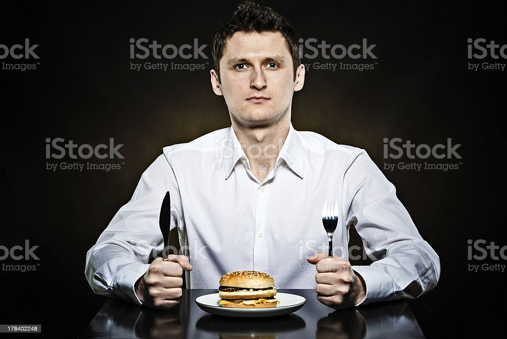 Hungry man is going to eat a burger stock photo
