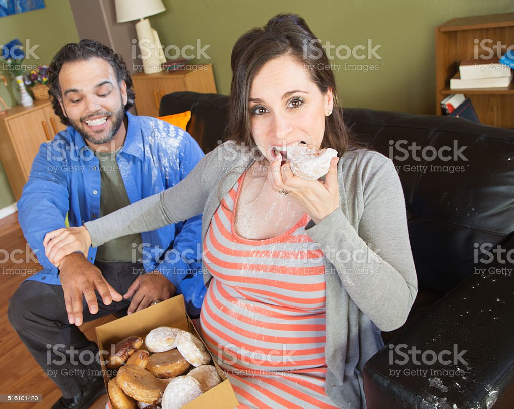 Hungry Pregnant Couple stock photo