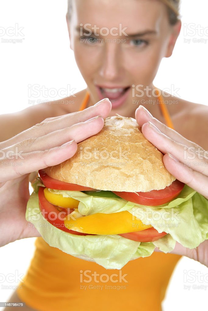 Hungry woman eating big burger royalty-free stock photo