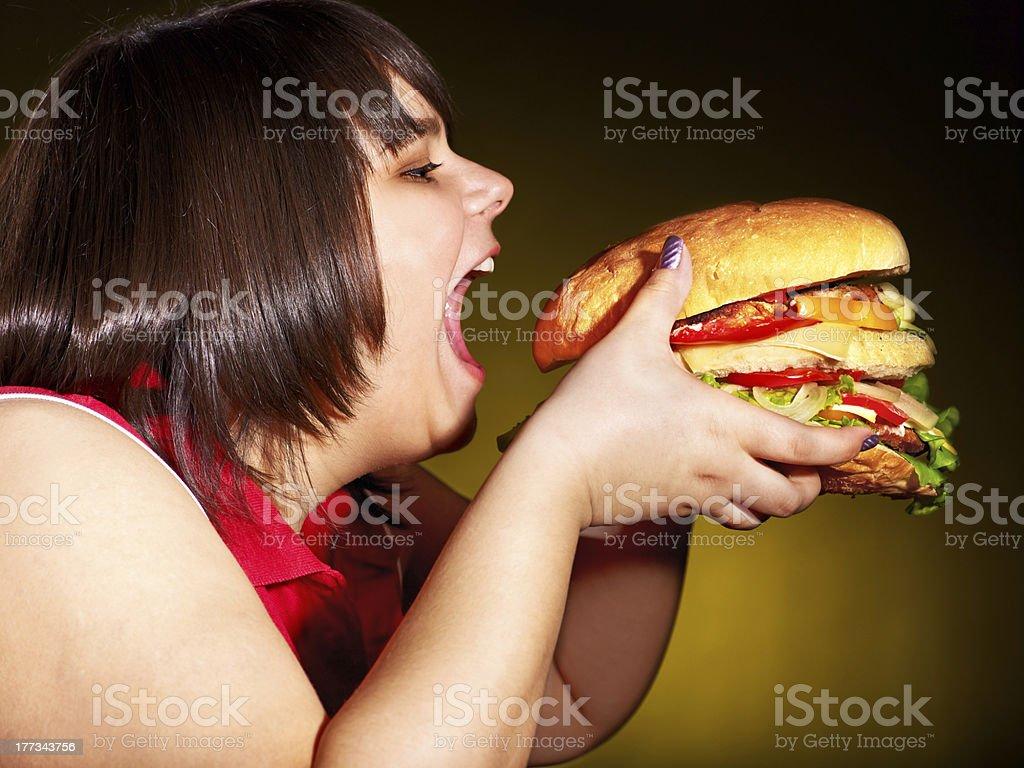 Hungry woman holding hamburger. royalty-free stock photo