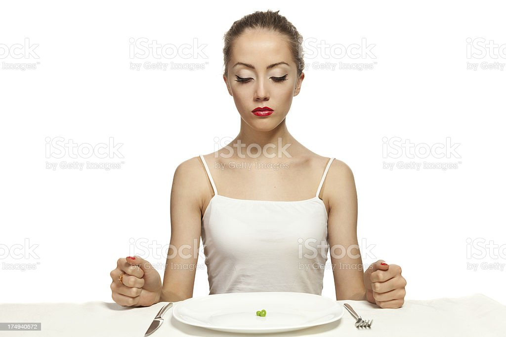 A hungry woman trying to discipline herself on a diet stock photo