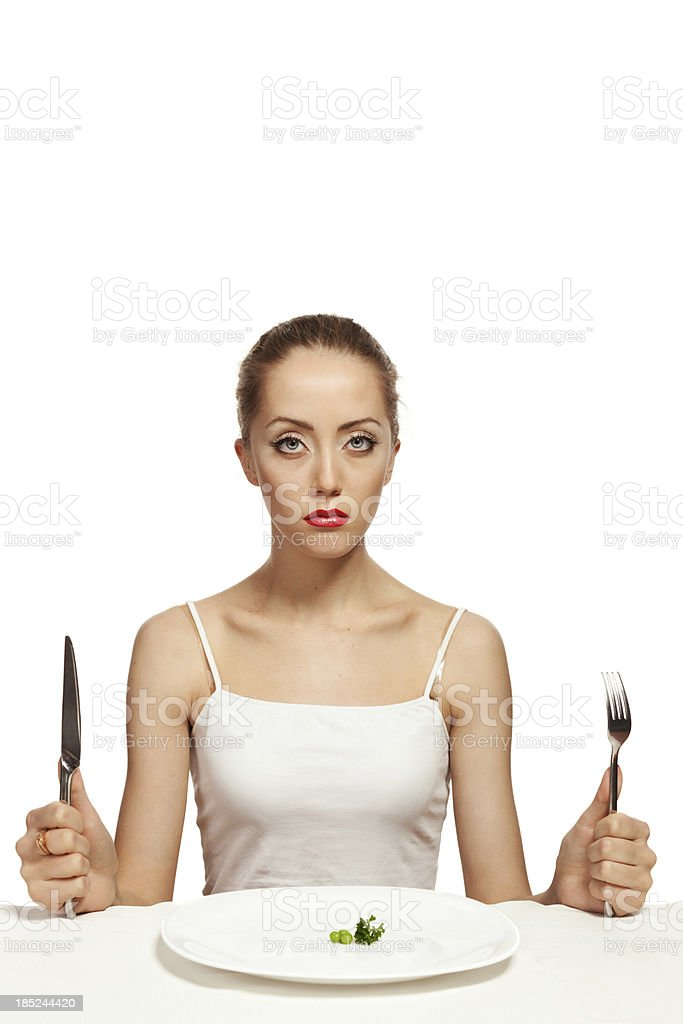Hungry young woman on a diet stock photo