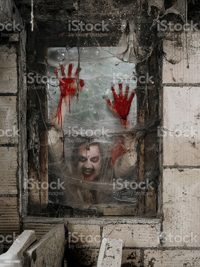 Hungry zombie at the window royalty-free stock photo
