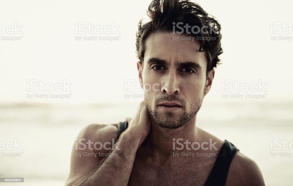 Hunk on the shore stock photo