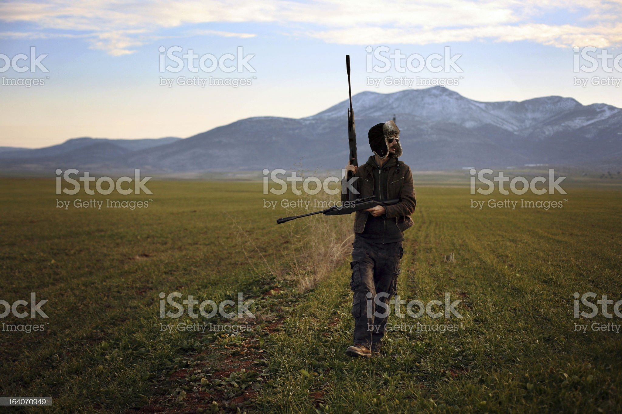 hunter aim with a rifle royalty-free stock photo