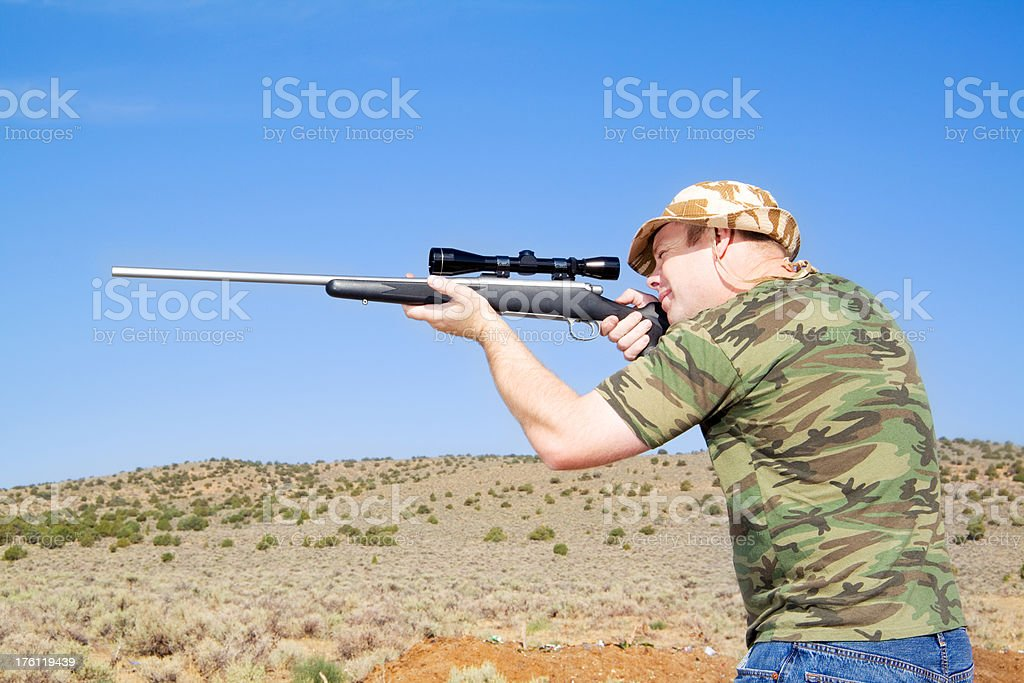 Hunter aiming a rifle royalty-free stock photo