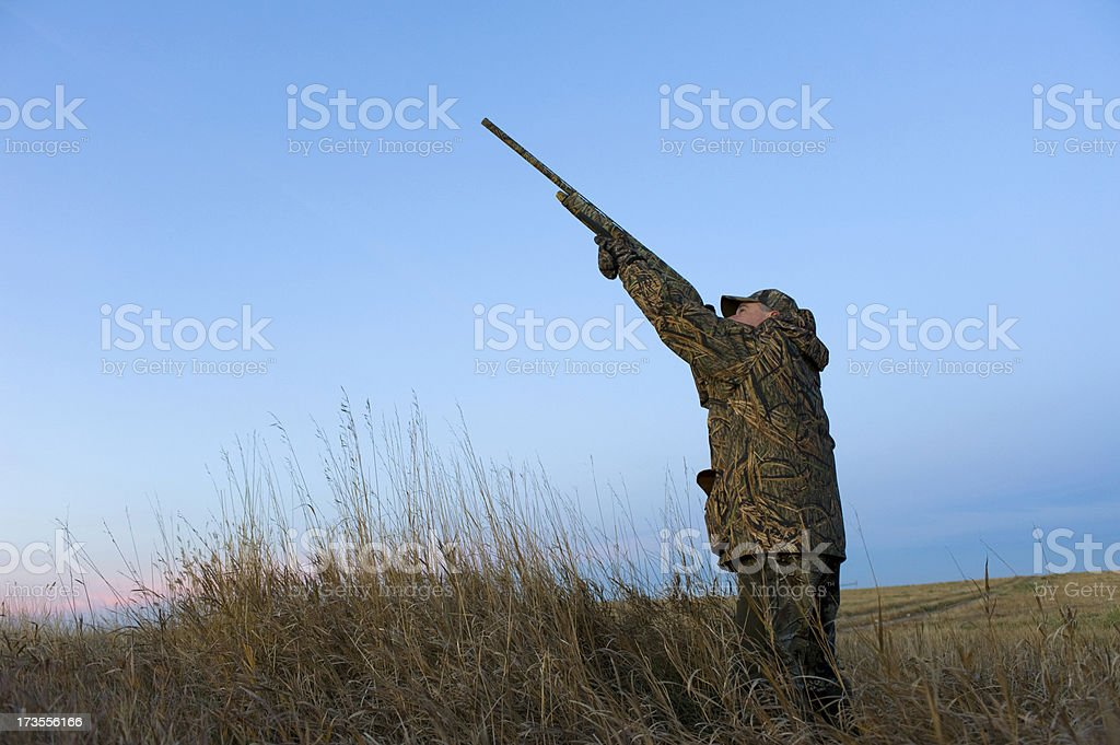 Hunter aiming up in the sky royalty-free stock photo