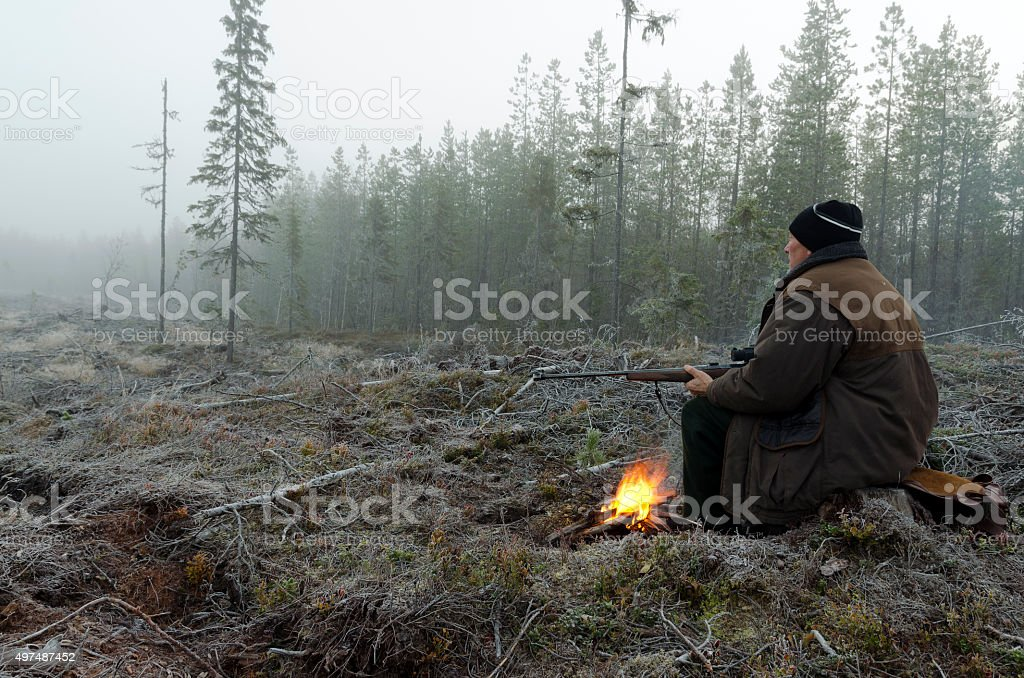 Hunter and fire stock photo