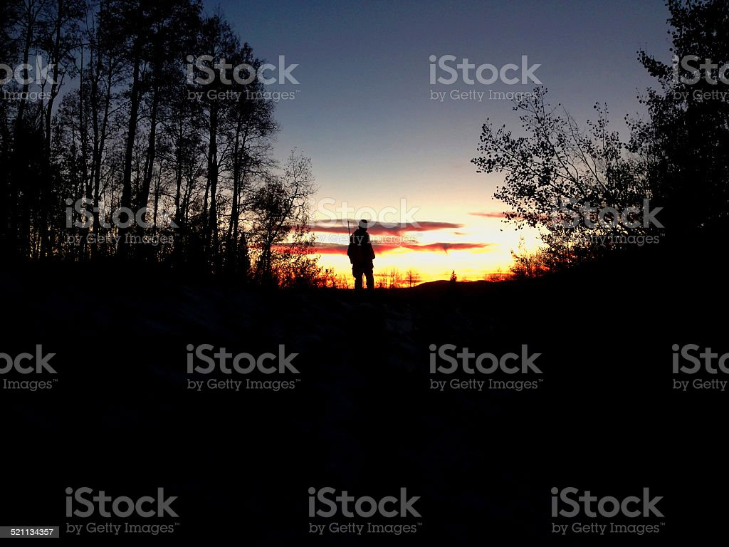 Hunter and Sunset stock photo