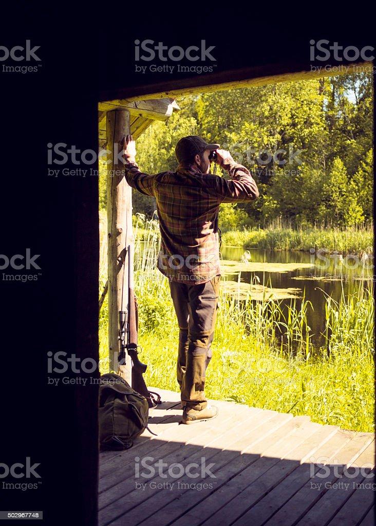 Hunter at Home Preparing to Start Hunting stock photo
