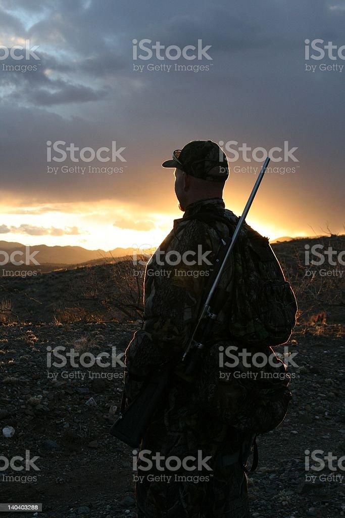 Hunter o zachodzie słońca zbiór zdjęć royalty-free