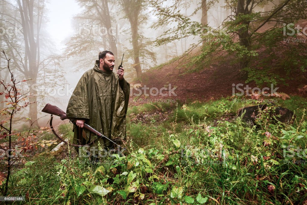 Hunter calling for others stock photo