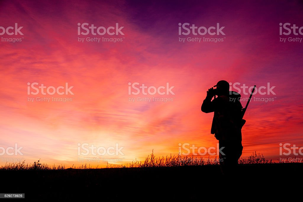 Hunter Glassing at Sunrise stock photo