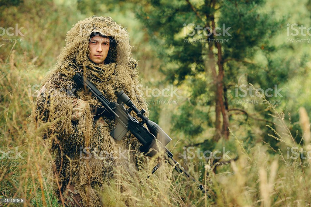 Hunter holds a gun stock photo