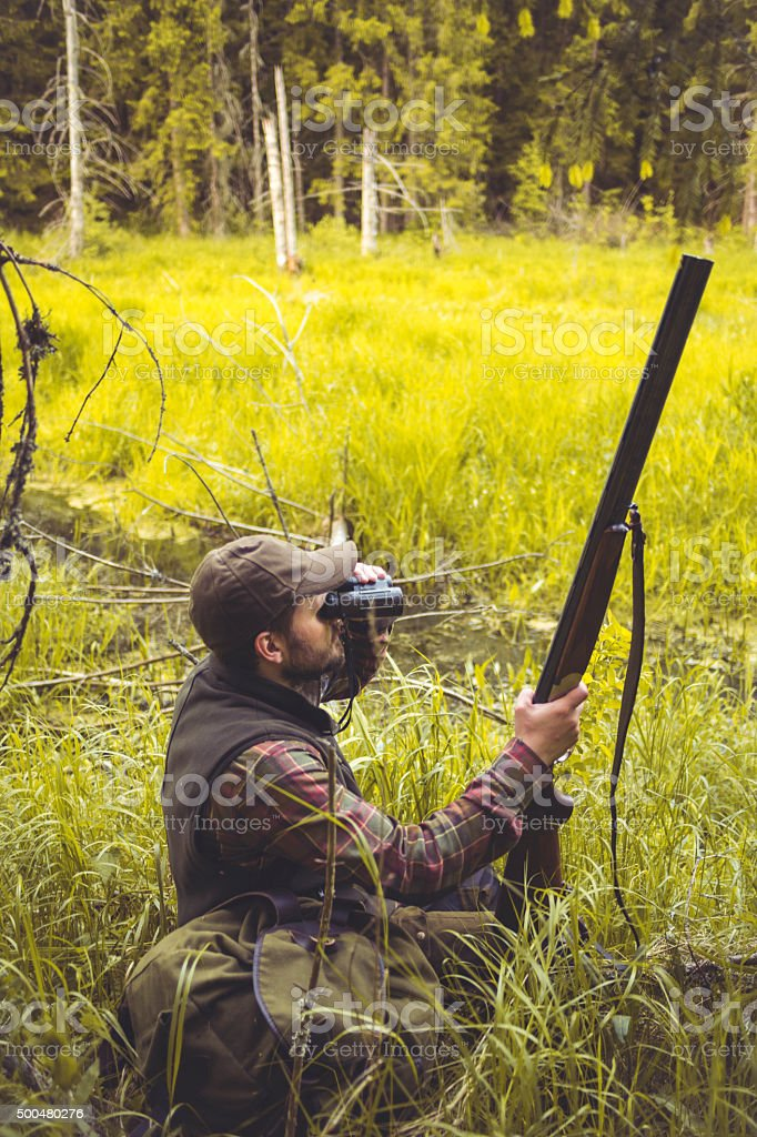 Hunter In Bog On The Watch stock photo