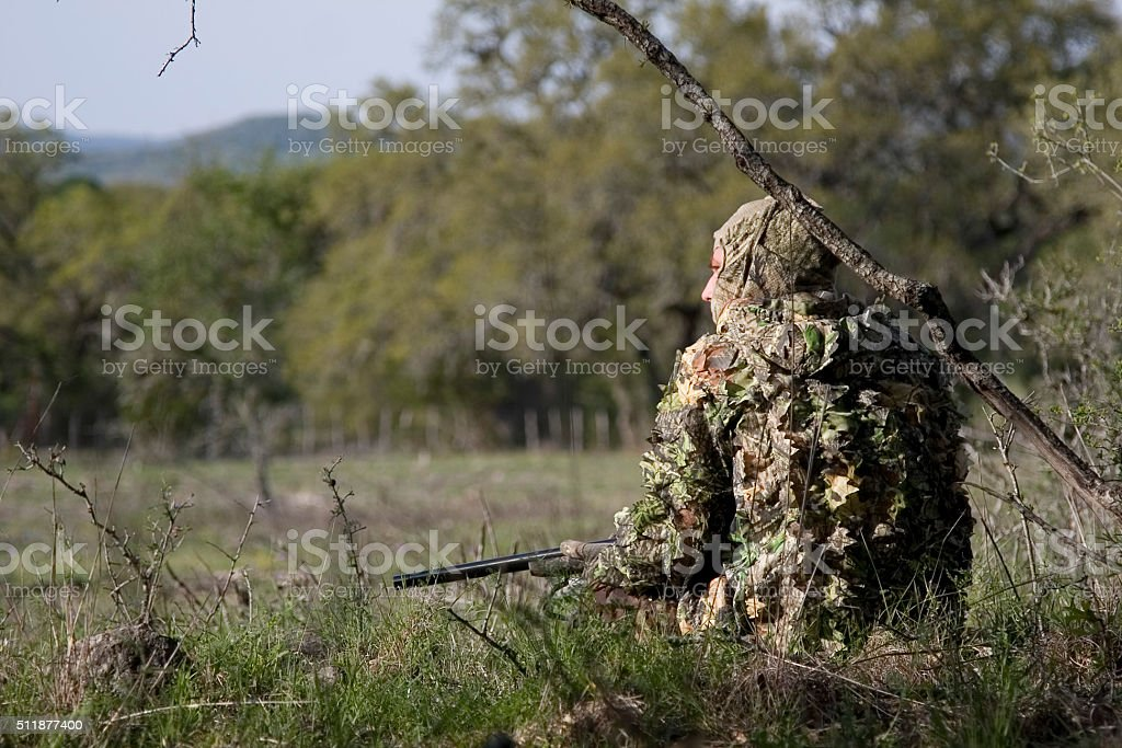 Hunter in camouflage stock photo