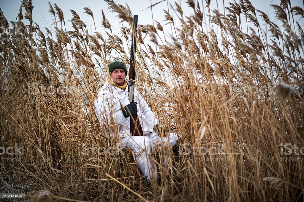 Hunter in the grass area stock photo