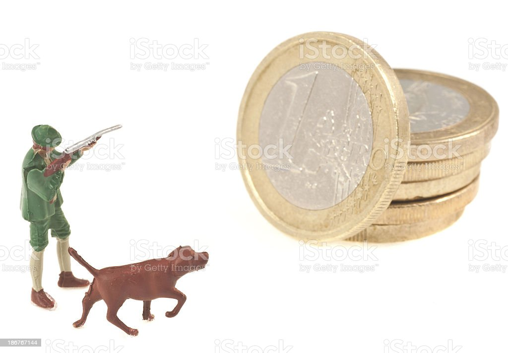 hunter is shooting on euro coin royalty-free stock photo