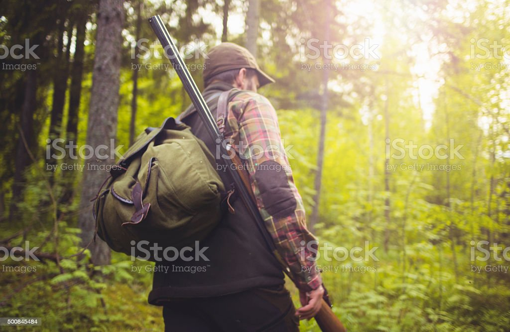 Hunter On A Hike Through Forest stock photo