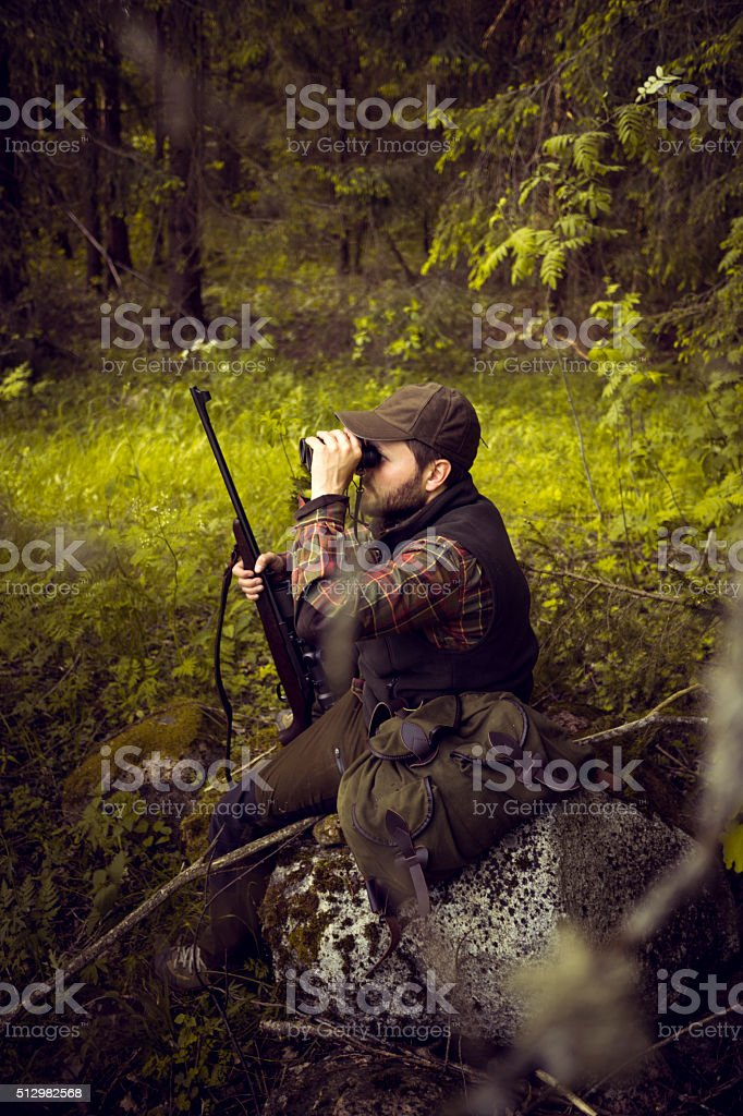 Hunter On The Outlook In The Forest Meadow stock photo