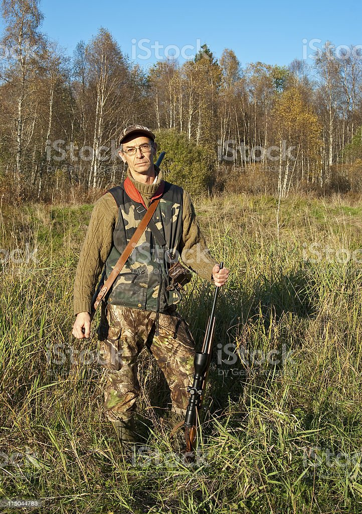 Hunter posing stock photo