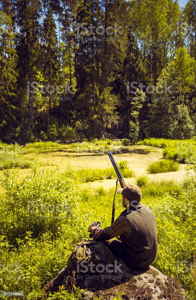 Hunter Resting In A Swamp Field stock photo