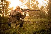 Hunter shooting with rifle